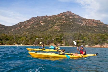 Cooper kayaking in Coles Bay
